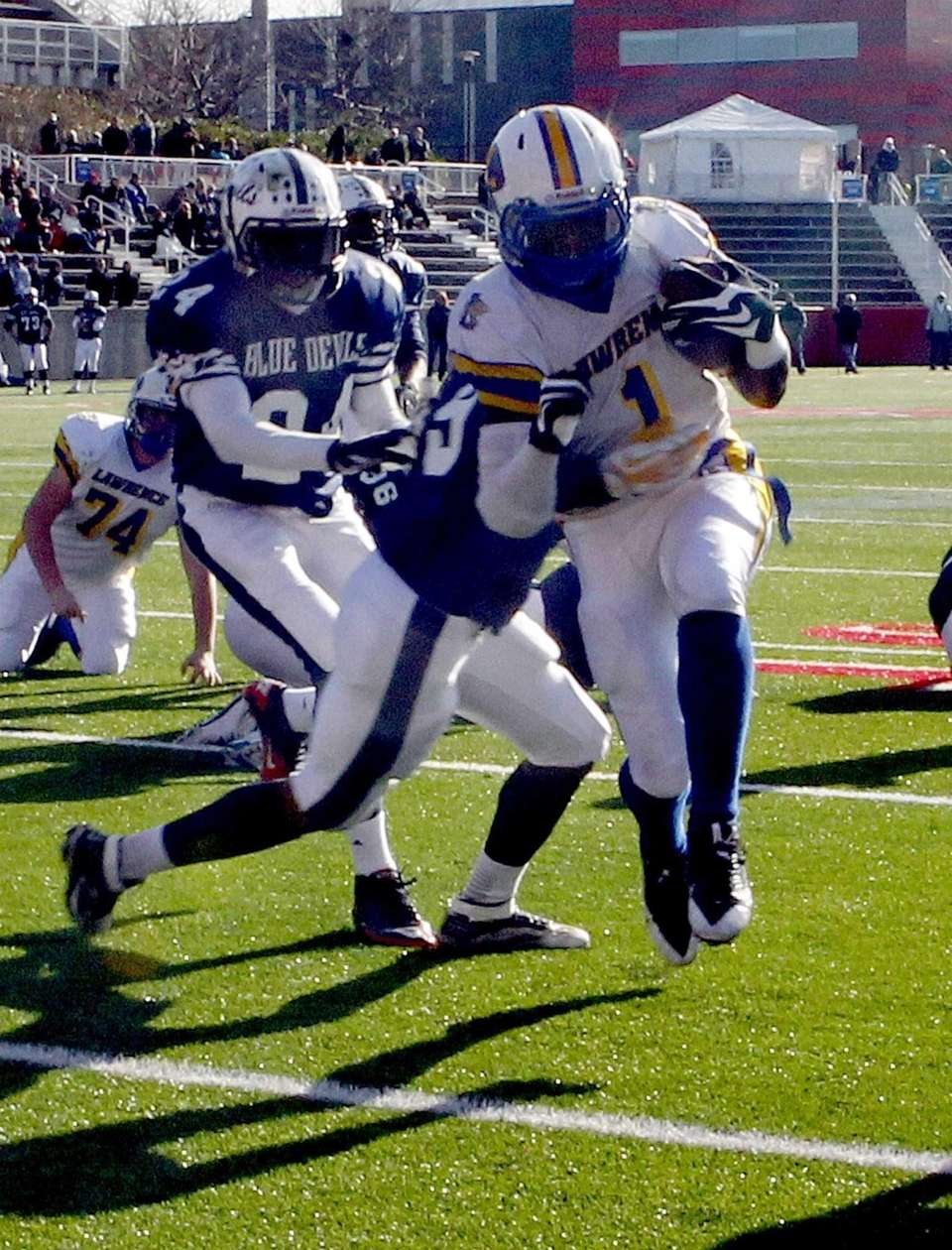 Lawrence's Jordan Fredericks runs in a touchdown during