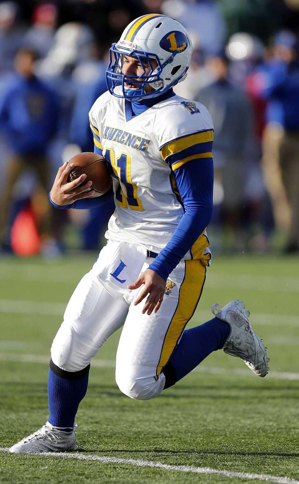 Lawrence quarterback Joe Capobianco keeps the ball in