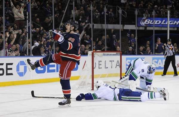 Chris Kreider reacts after scoring on Vancouver Canucks