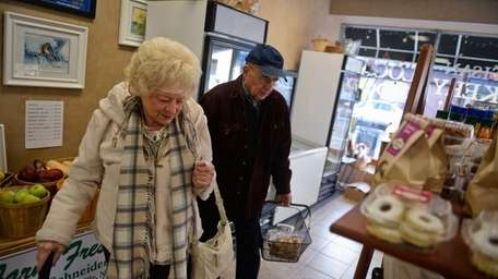 Delores and Walter Henning, of Bay Shore, shop