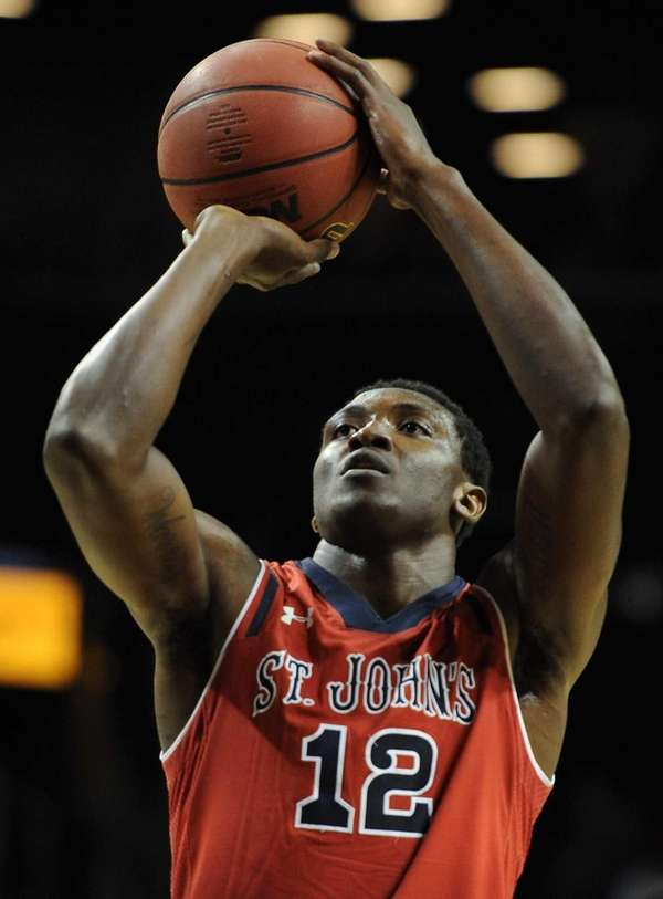 St. John's center Chris Obekpa shoots a free