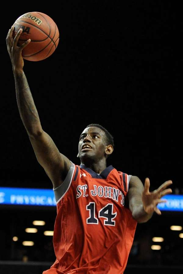 St. John's forward Jakarr Sampson shoots against Georgia