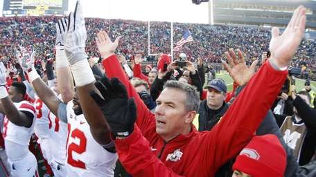Ohio State head coach Urban Meyer joins his