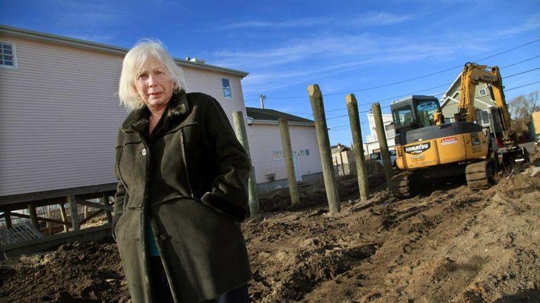 Eve Hough, 71, of Lindenhurst, stands on the
