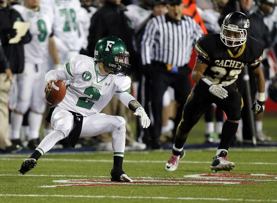 Farmingdale quarterback Vinny Quinn (no. 2) is pursued