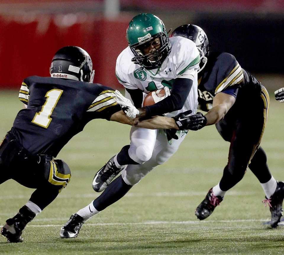 Farmingdale running back Curtis Jenkins (10) cuts back