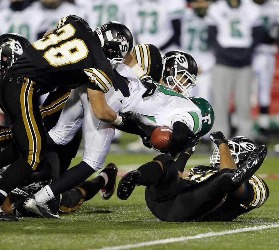 The Sachem North defense stops Farmingdale's Curtis Jenkins