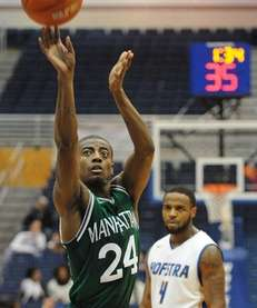 Manhattan forward George Beamon shoots a free throw