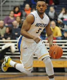 Hofstra guard Zeke Upshaw dribbles upcourt against Manhattan