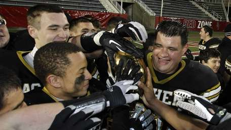 Sachem North players hold the Class I trophy