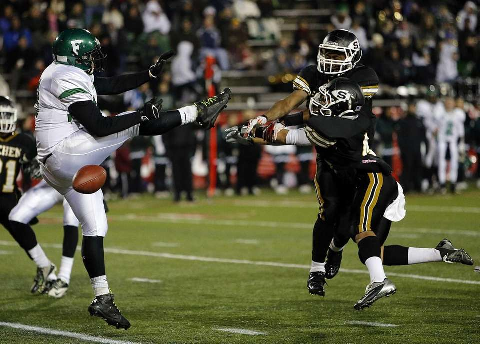 Sachem North's Malik Pierre (5) and Jasheem Banks