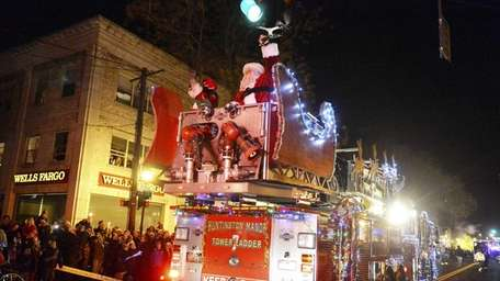 Festive fire trucks travel down New York Avenue