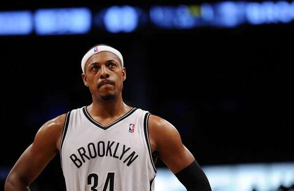 Nets forward Paul Pierce looks on during the