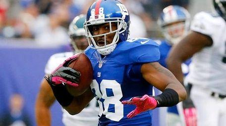 Giants wide receiver Hakeem Nicks looks to gain