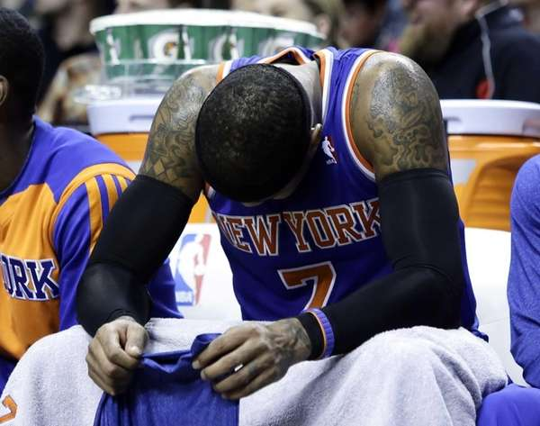 Knicks forward Carmelo Anthony sits on the bench