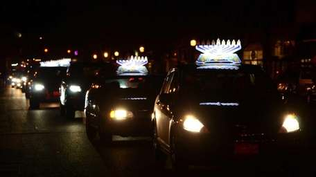 To celebrate Hanukkah, cars decorated with lighted menorahs,