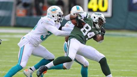 Stephen Hill gets tackled during the first half