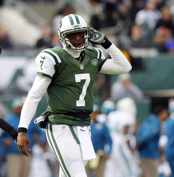 Geno Smith walks to the sidelines after losing