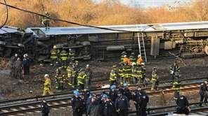 Emergency workers on the scene of the derailed