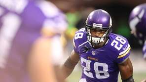 Minnesota Vikings running back Adrian Peterson takes the