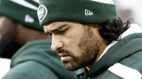 Mark Sanchez walks on the sidelines during a