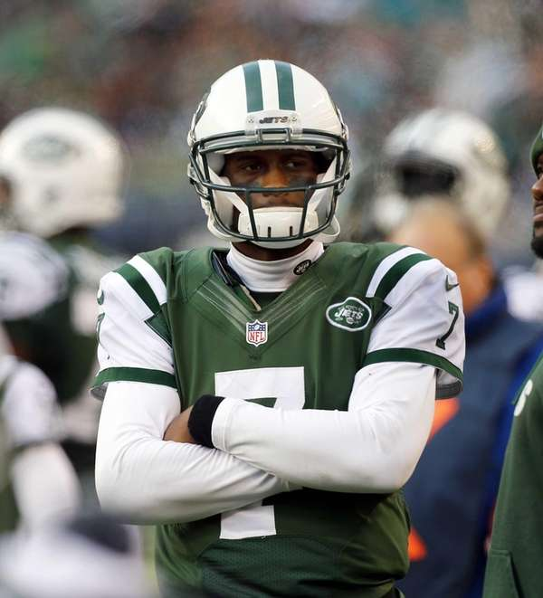 Geno Smith looks on early in the third