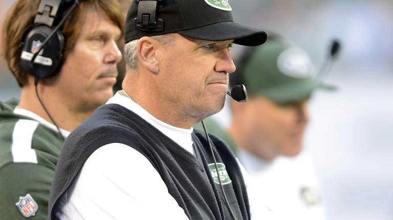 New York Jets Manager Rex Ryan watches from