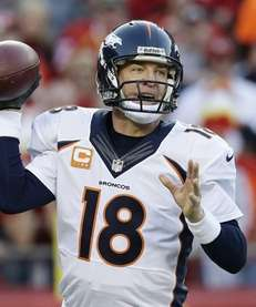 Denver Broncos quarterback Peyton Manning looks for a