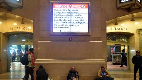 Commuters at Grand Central Station attempt to find