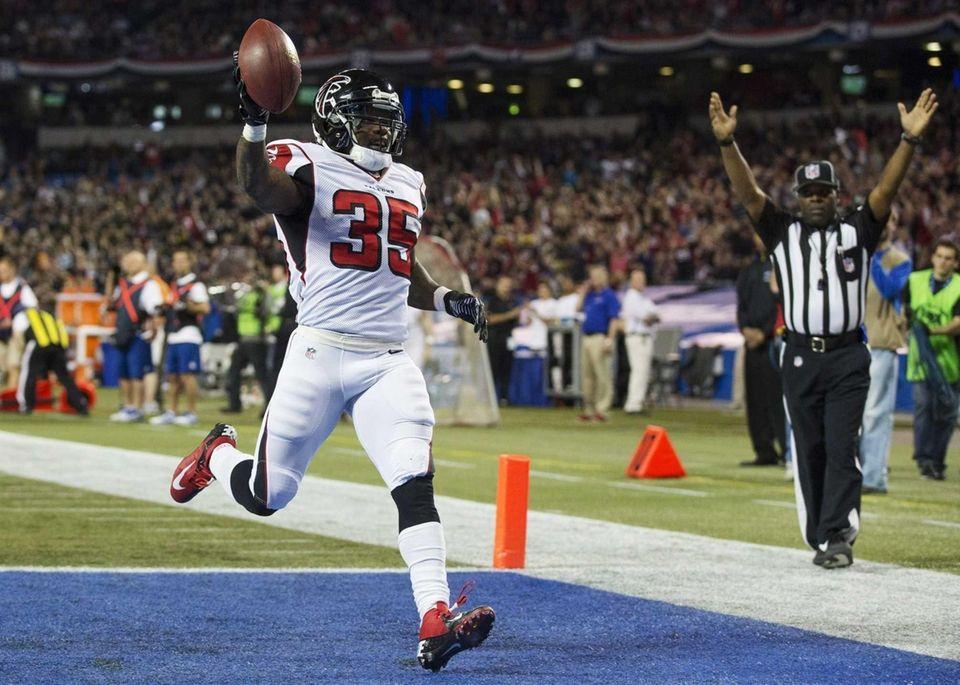 Atlanta Falcons Antone Smith celebrates his touchdown against