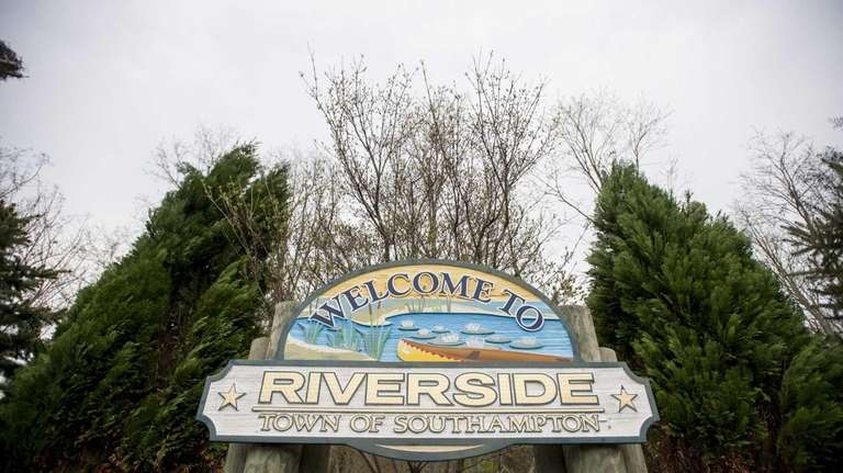 A sign welcoming drivers to Riverside, along Flanders