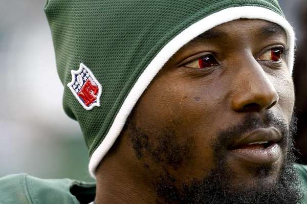Jets wide receiver Santonio Holmes looks on during