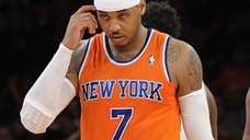 Knicks forward Carmelo Anthony looks on from the