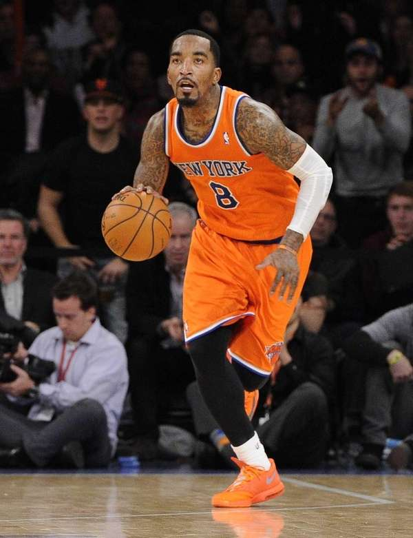 Knicks guard J.R. Smith dribbles the ball down