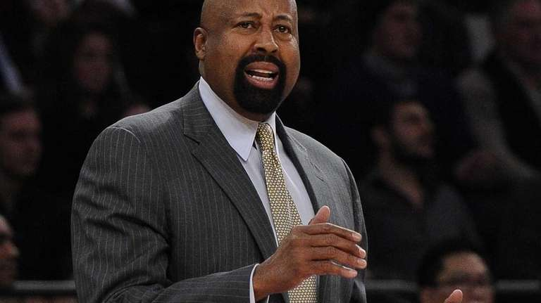 Knicks head coach Mike Woodson reacts against the