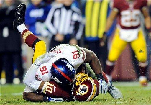 Washington Redskins quarterback Robert Griffin III (10) is