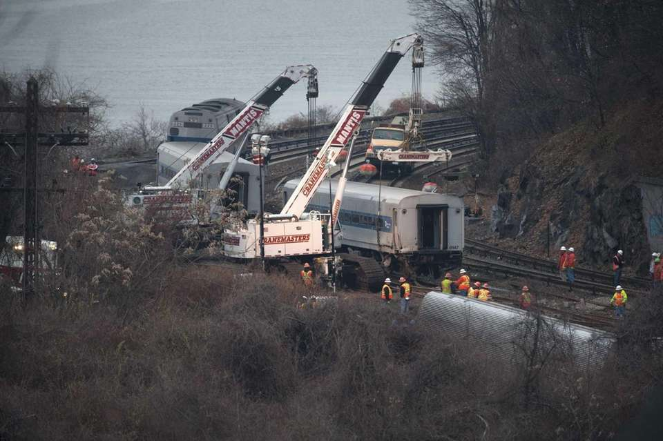 Cranes are used to right derailed Metro-North train