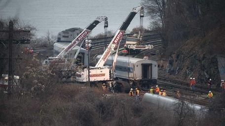 Cranes are used to right derailed Metro-North train