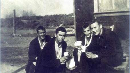 Gerald A. O'Reilly (center foreground, eyes shut) recovering