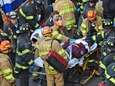 Emergency personnel offer treatment to a passenger of