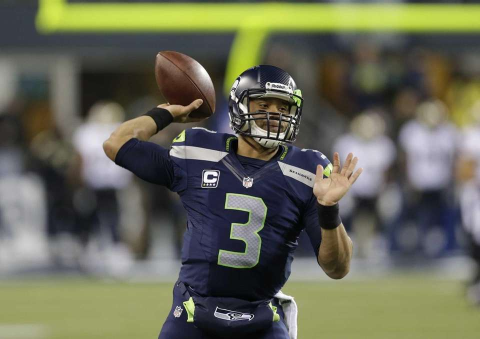Seattle Seahawks quarterback Russell Wilson throws during warmups