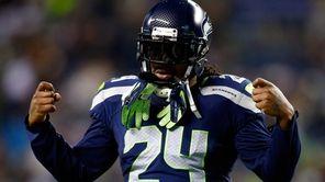 Seattle Seahawks running back Marshawn Lynch looks on