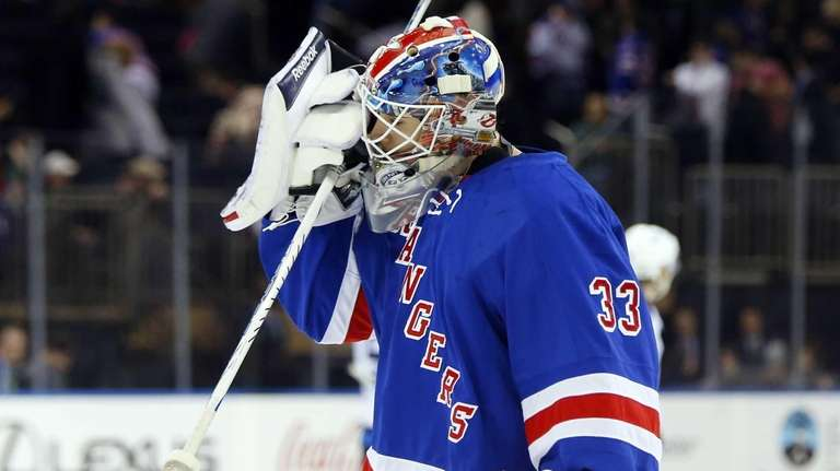 Cam Talbot skates back to the net after