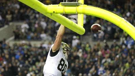 New Orleans Saints' Jimmy Graham spikes the ball