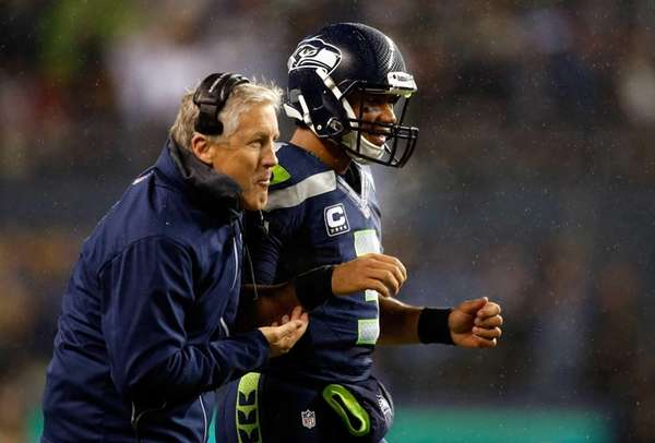 Seattle Seahawks quarterback Russell Wilson and head coach