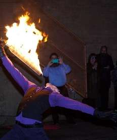 Fire performer Benjamin Reynolds entertains the crowd at