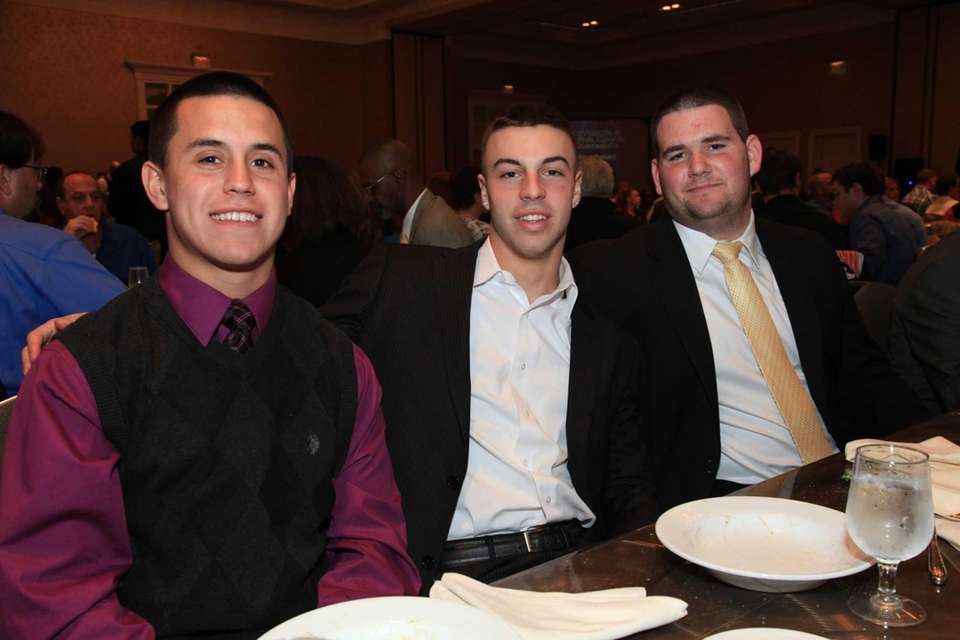 Members of the Commack Cougars anticipate a night