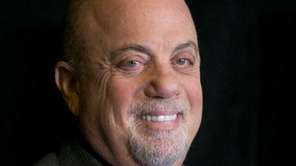 Billy Joel smiles at a news conference at