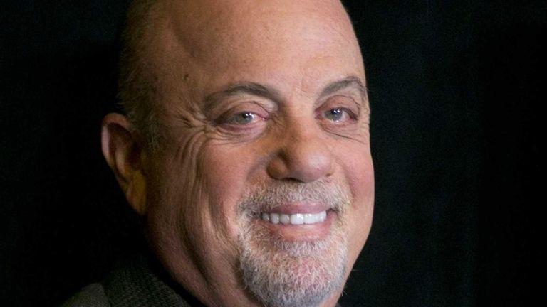 Billy Joel smiles at a news conference at