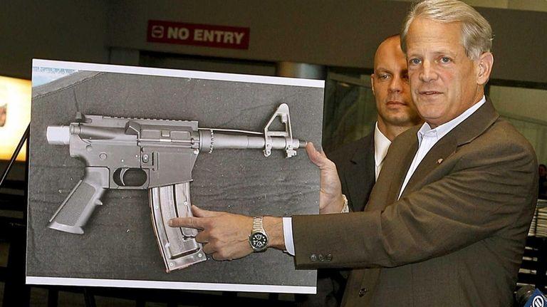Congressman Steve Israel (D-Huntington) holds up a photo